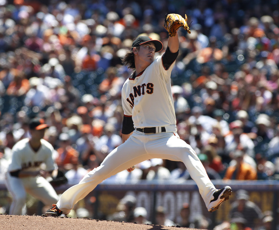 Photo - San Francisco Giants pitcher Tim Lincecum throws to the Philadelphia Phillies during the first inning of a baseball game, Sunday, Aug. 17, 2014, in San Francisco. (AP Photo/George Nikitin)