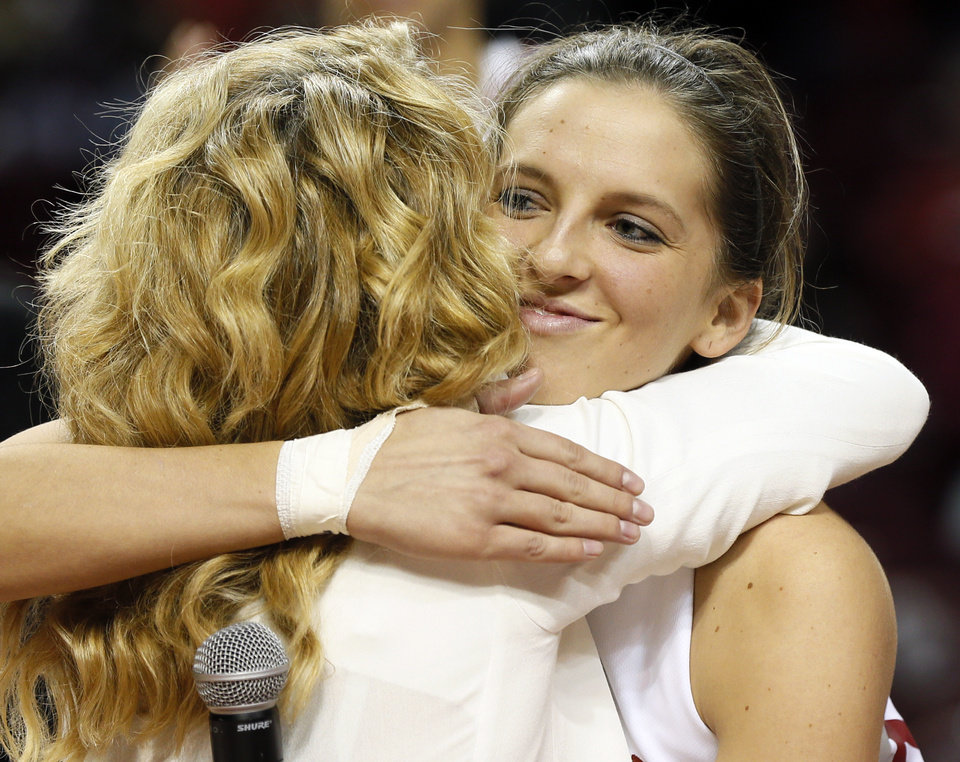 Photo - OU senior Morgan Hook (10) hugs head coach Sherri Coale during senior night activities after a women's college basketball game between the Oklahoma Sooners and Texas Tech at Lloyd Noble Center in Norman, Okla., Monday, March 3, 2014. OU won 87-32. Photo by Nate Billings, The Oklahoman