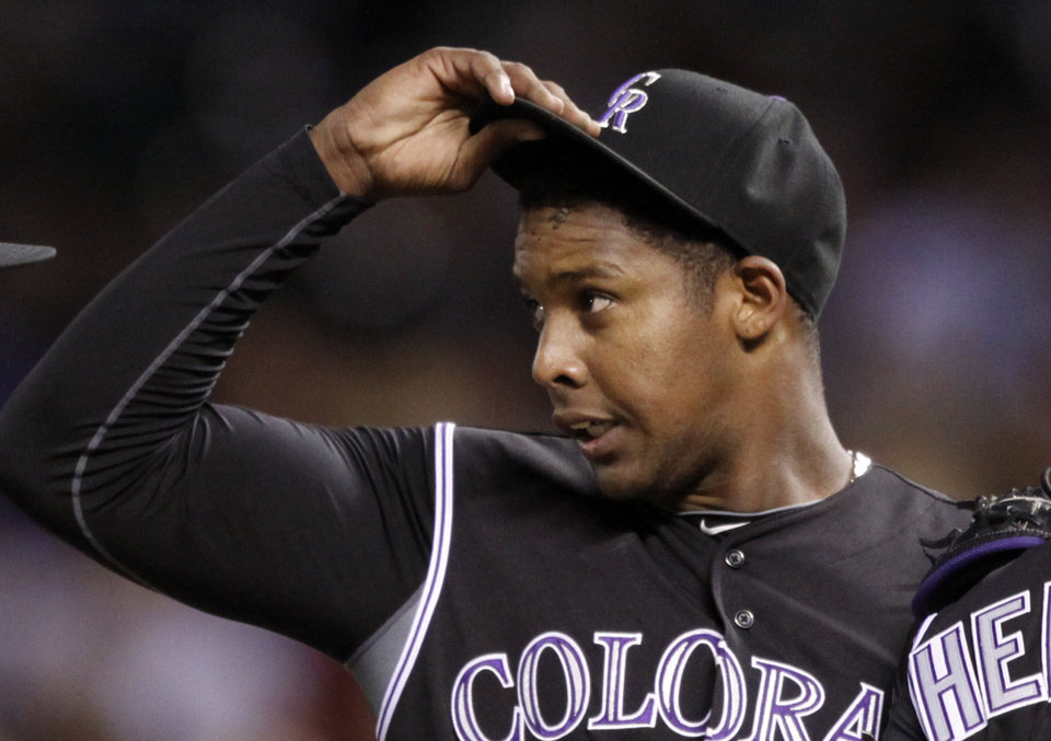 Photo -   Colorado Rockies starting pitcher Juan Nicasio reacts after a meeting at the mound during the third inning of a baseball game against the Arizona Diamondbacks, Friday, April 13, 2012, in Denver. Nicasio was pulled after the next batter. (AP Photo/Jack Dempsey)