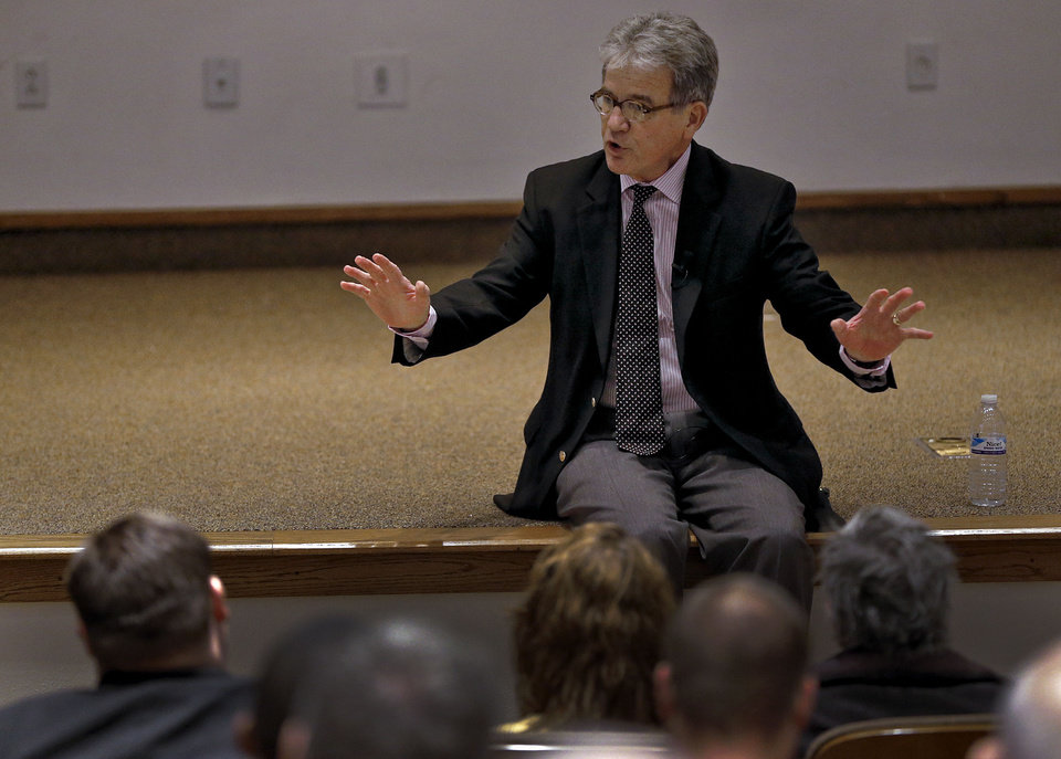 Photo - U.S. Senator Tom Coburn speaks during his town hall meeting Wednesday at the Metro Tech Springlake campus in Oklahoma City.  Photo by Chris Landsberger, The Oklahoman  CHRIS LANDSBERGER