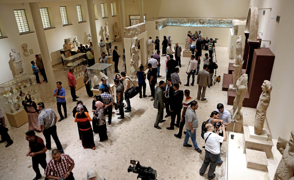 Photo - Stone figures depicting the family of Sanatruq are showcased at the Iraqi National Museum in Baghdad, Iraq, Thursday, Aug 21, 2014. Two renovated halls adorned mainly with rare life-size stone statues were inaugurated at the Iraqi National Museum on Thursday geared toward honoring the 5,000 year legacy of the ancient city of Hatra. (AP Photo/Hadi Mizban)