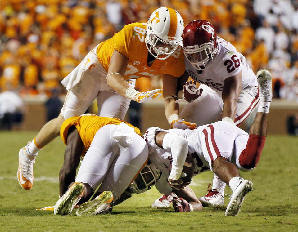 Photo - Oklahoma's Zack Sanchez (15) intercepts as pass intended for Tennessee's Marquez North (8) to end the game in double overtime as Oklahoma's Jordan Evans (26) and Tennessee's Ethan Wolf (82) converge on the play during a college football game between the Oklahoma Sooners (OU) and the Tennessee Volunteers at Neyland Stadium in Knoxville, Tennessee, Saturday, Sept. 12, 2015. OU won 31-24 in double overtime. Photo by Nate Billings, The Oklahoman