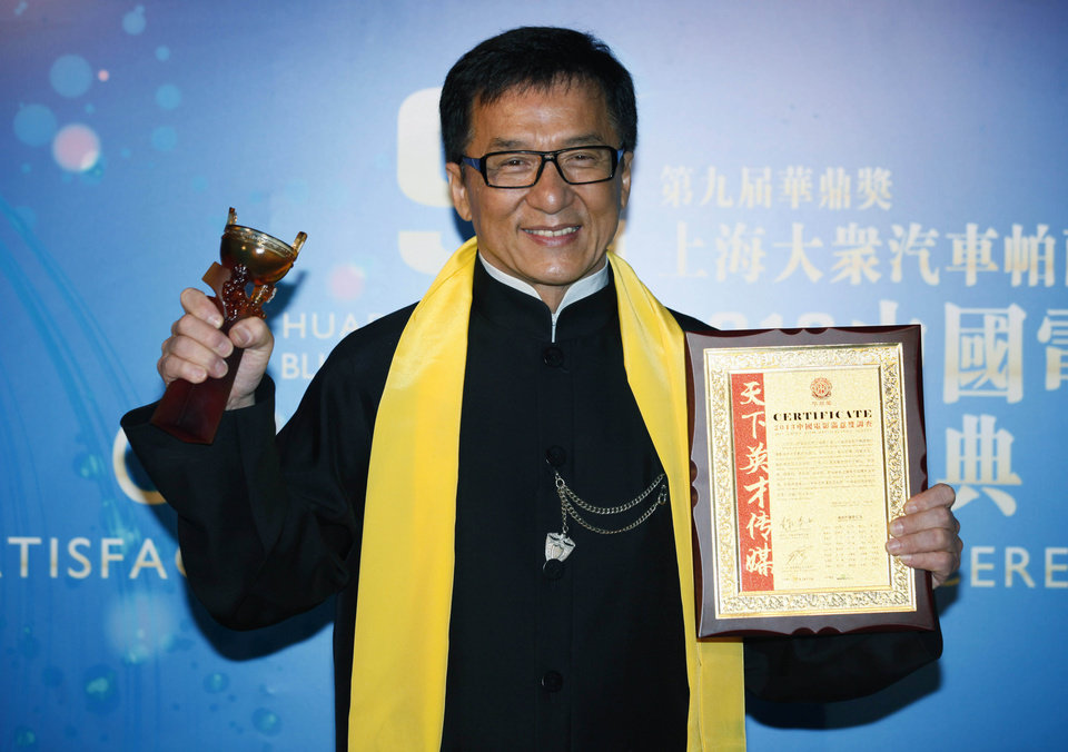 Photo - FILE - In this Wednesday, April 10, 2013 file photo, Hong Kong movie star Jackie Chan poses after winning the Best Action Movie in China Award at the Huading Awards in Hong Kong. Chan has received a lot of awards during a career that's spanned 50 years. But a best director award is rare on his trophy shelves. The action star took home one Wednesday night for his 100th film,