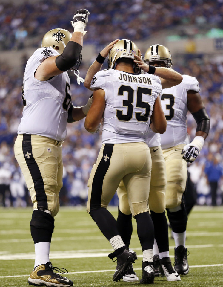 Photo - New Orleans Saints fullback Austin Johnson (35) celebrates with teammates after scoring a touchdown against the Indianapolis Colts during the first half of an NFL preseason football game in Indianapolis, Saturday, Aug. 23, 2014. (AP Photo/Sam Riche)
