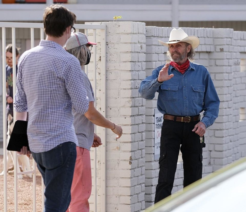 Photo - Actor Luce Rains, right, talks to crew members on the set of the Oklahoma film
