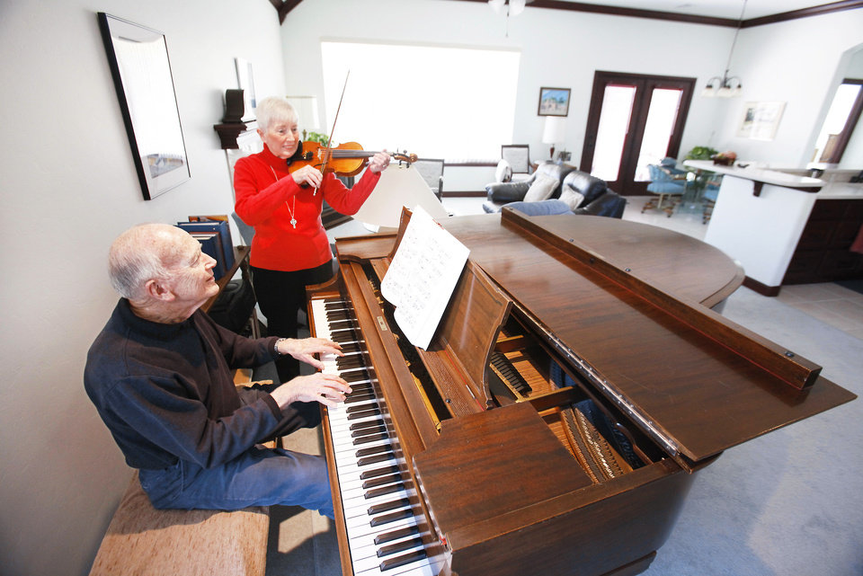 Ron and Vivian Waddell play music at their home at Touchmark at Coffee Creek in Edmond.  Photos by David McDaniel, The Oklahoman