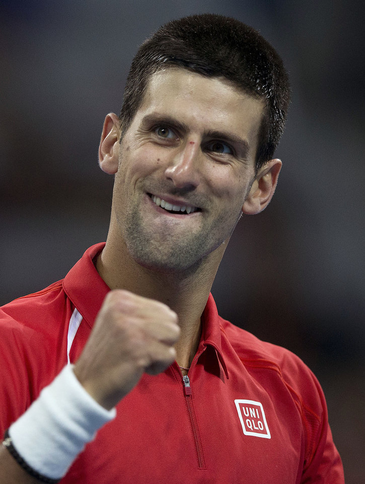 Photo -   Serbia's Novak Djokovic reacts after he scored a set point against Jurgen Melzer of Austria during their men's singles quarterfinal match of the China Open tennis tournament in Beijing Friday, Oct. 5, 2012. Djokovic defeated Melzer 6-1, 6-2. (AP Photo/Andy Wong)
