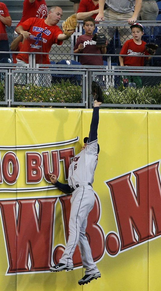 Photo - Houston Astros center fielder Jake Marisnick cannot reach a home run by Philadelphia Phillies' Ryan Howard during the second inning of an interleague baseball game, Tuesday, Aug. 5, 2014, in Philadelphia. (AP Photo/Matt Slocum)