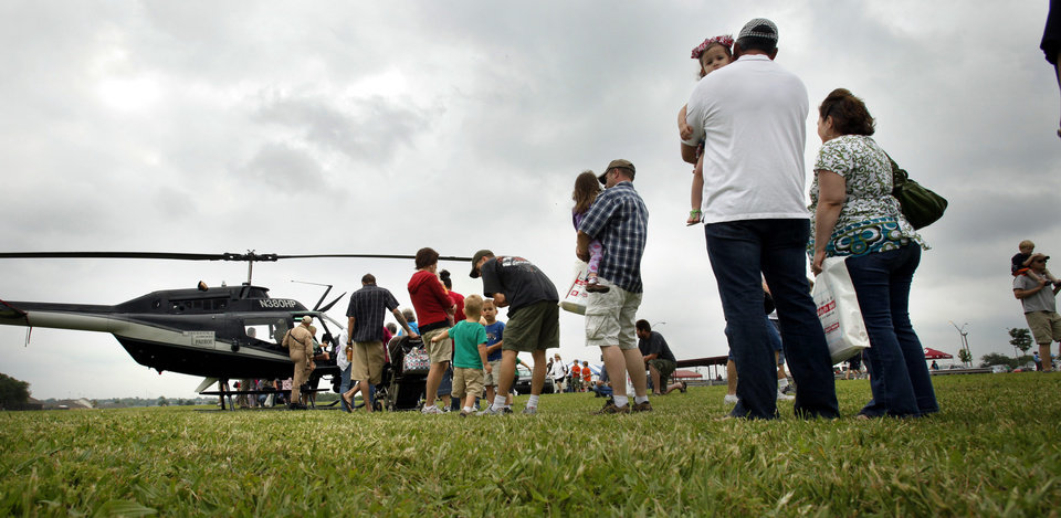"Parents and children line up to get a seat in the Oklahoma Hishway Patrol Helicopter at the annual ""Touch a Truck"" event on Saturday, April 28, 2012, in Norman, Okla.  Photo by Steve Sisney, The Oklahoman"