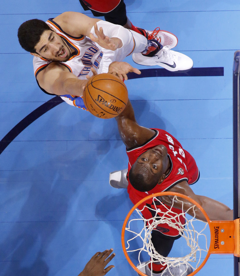 Photo - Oklahoma City's Enes Kanter (11) puts up a shot beside Toronto's Bismack Biyombo (8) during an NBA basketball game between the Oklahoma City Thunder and the Toronto Raptors at Chesapeake Energy Arena on Wednesday, Nov. 4, 2015. The Thunder lost 103-98. Photo by Bryan Terry, The Oklahoman