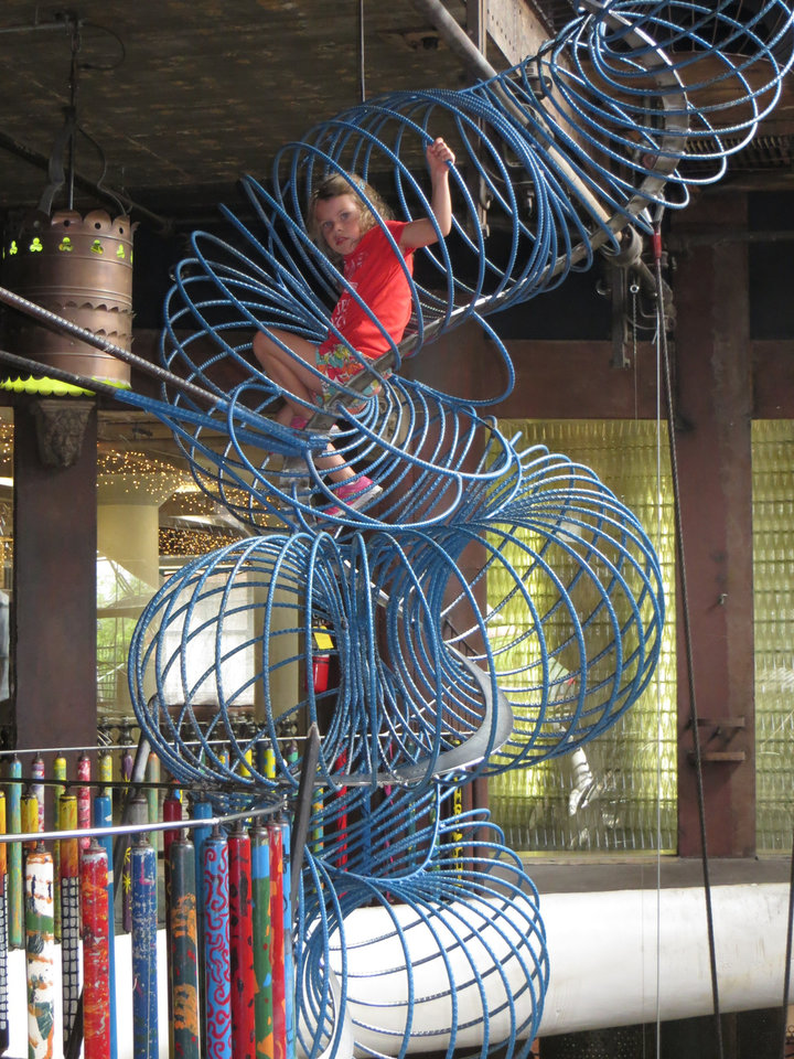 "Photo -  Known affectionately as ""slinkies of death,"" refrigeration coils at City Museum become climbers for agile visitors. Photo by Elaine Warner, for The Oklahoman"