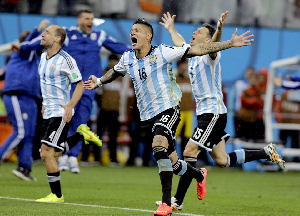 Photo - Argentine players react after Maxi Rodriguez scored the winning goal during a penalty shootout after extra time during the World Cup semifinal soccer match between the Netherlands and Argentina at the Itaquerao Stadium in Sao Paulo Brazil, Wednesday, July 9, 2014. Argentina defeated the Netherlands 4-2 in a penalty shootout after a 0-0 tie to advance to the finals. (AP Photo/Victor R. Caivano)