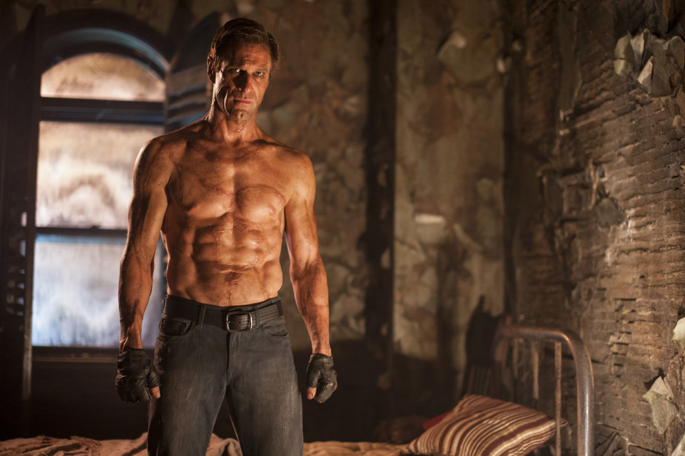 Photo - This image released by Lionsgate shows Aaron Eckhart in a scene from the film,
