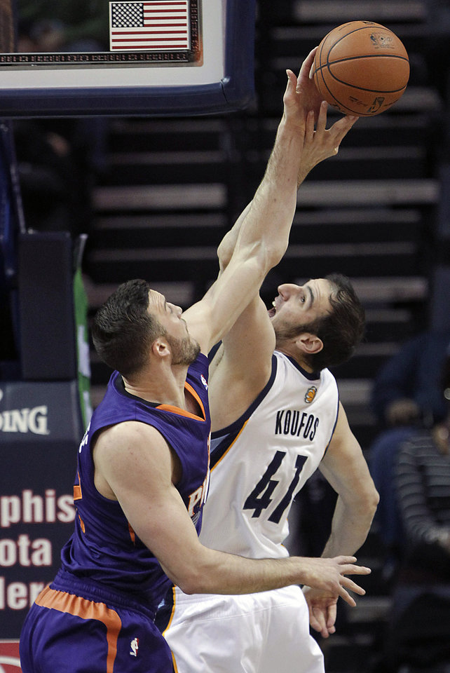 Photo - Memphis Grizzlies center Kosta Koufos (41) fights for a rebound against Phoenix Suns center Miles Plumlee, left, in the first half of an NBA basketball game, Friday, Jan. 10, 2014, in Memphis, Tenn. (AP Photo/Lance Murphey)
