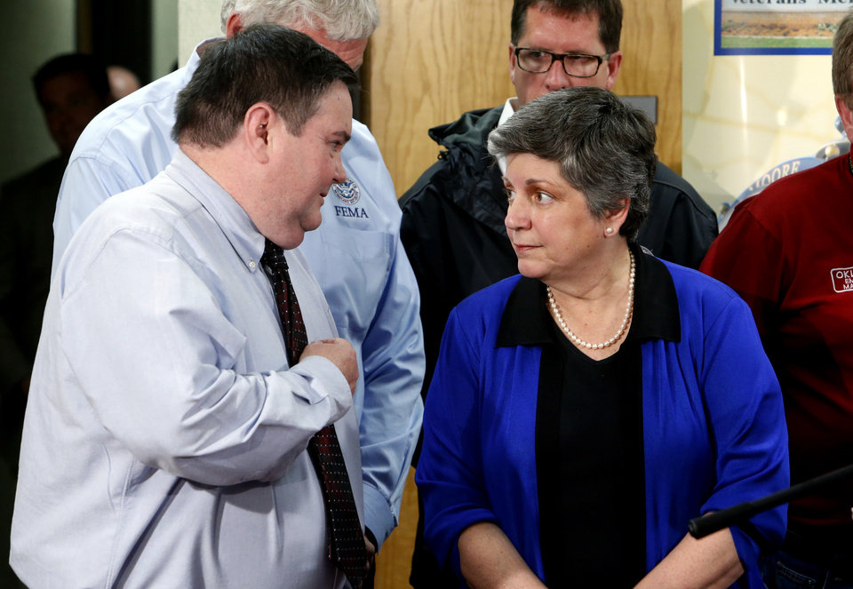 Photo - Moore mayor Glenn Lewis speaks with United State Secretary of Homeland Security Janet Napolitano at a press conference concerning damage from Monday's tornado on Wednesday, May 22, 2013 at city hall in Moore, Okla. Photo by Steve Sisney, The Oklahoman