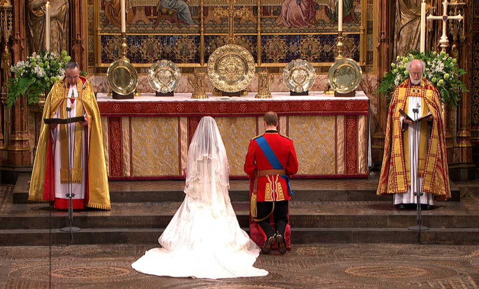 Photo - In this image taken from video, Britain's Prince William, right, and his wife, Kate, the Dutchess of Cambridge, kneel at the altar at Westminster Abbey for the Royal Wedding in London on Friday, April, 29, 2011. (AP Photo/APTN) EDITORIAL USE ONLY NO ARCHIVE PHOTO TO BE USED SOLELY TO ILLUSTRATE NEWS REPORTING OR COMMENTARY ON THE FACTS OR EVENTS DEPICTED IN THIS IMAGE ORG XMIT: RWVM193