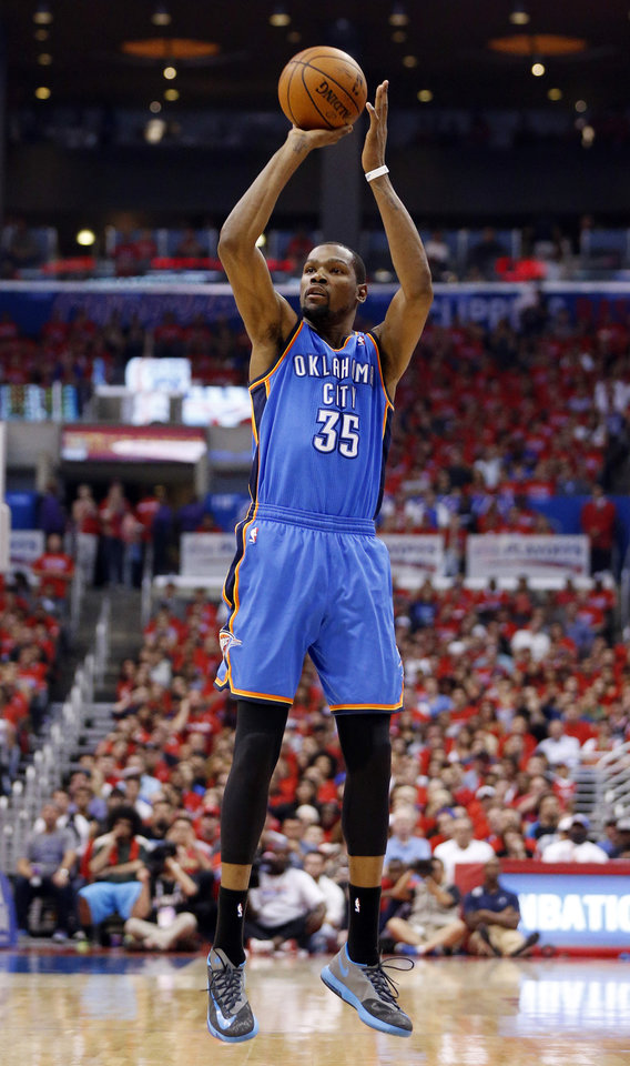 Photo - Oklahoma City's Kevin Durant (35) shoots a 3-point shot during Game 6 of the Western Conference semifinals in the NBA playoffs between the Oklahoma City Thunder and the Los Angeles Clippers at the Staples Center in Los Angeles, Thursday, May 15, 2014. Photo by Nate Billings, The Oklahoman