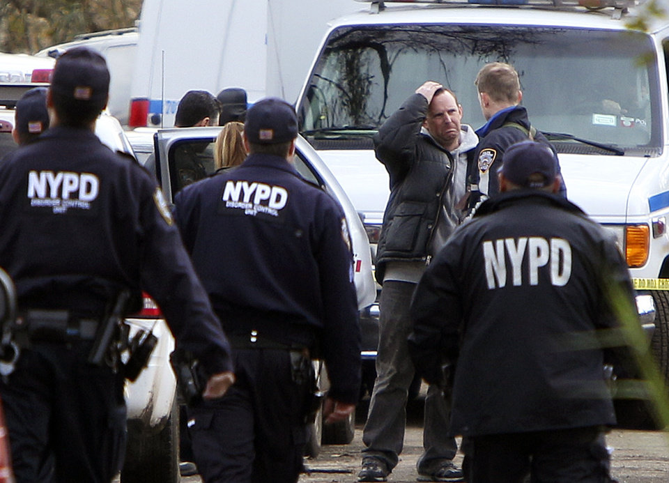 Damian Moore, reacts as he approaches the scene where at least one of his childrens\' bodies were discovered in Staten Island, New York, Thursday, Nov. 1, 2012. Brandon Moore, 2, and Connor Moore, 4, were swiped into swirling waters as their mother tried to escape her SUV on Monday amid rushing waters that caused the vehicle to stall during Superstorm Sandy. Police said the mother, Glenda Moore, was going to her sister\'s home in Brooklyn when she tried to flee the vehicle with the boys, only to have the force of the rising water and the relentless cadence of pounding waves rip the boy\'s small arms from her. (AP Photo/Seth Wenig) ORG XMIT: NYSW123