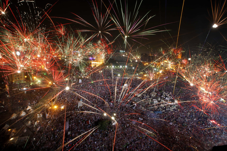 "Fireworks light the sky opponents of Egypt's Islamist President Mohammed Morsi celebrate in Tahrir Square in Cairo, Egypt, Wednesday, July 3, 2013. A statement on the Egyptian president's office's Twitter account has quoted Mohammed Morsi as calling military measures ""a full coup."" The denouncement was posted shortly after the Egyptian military announced it was ousting Morsi, who was Egypt's first freely elected leader but drew ire with his Islamist leanings. The military says it has replaced him with the chief justice of the Supreme constitutional Court, called for early presidential election and suspended the Islamist-backed constitution.(AP Photo/Amr Nabil)"