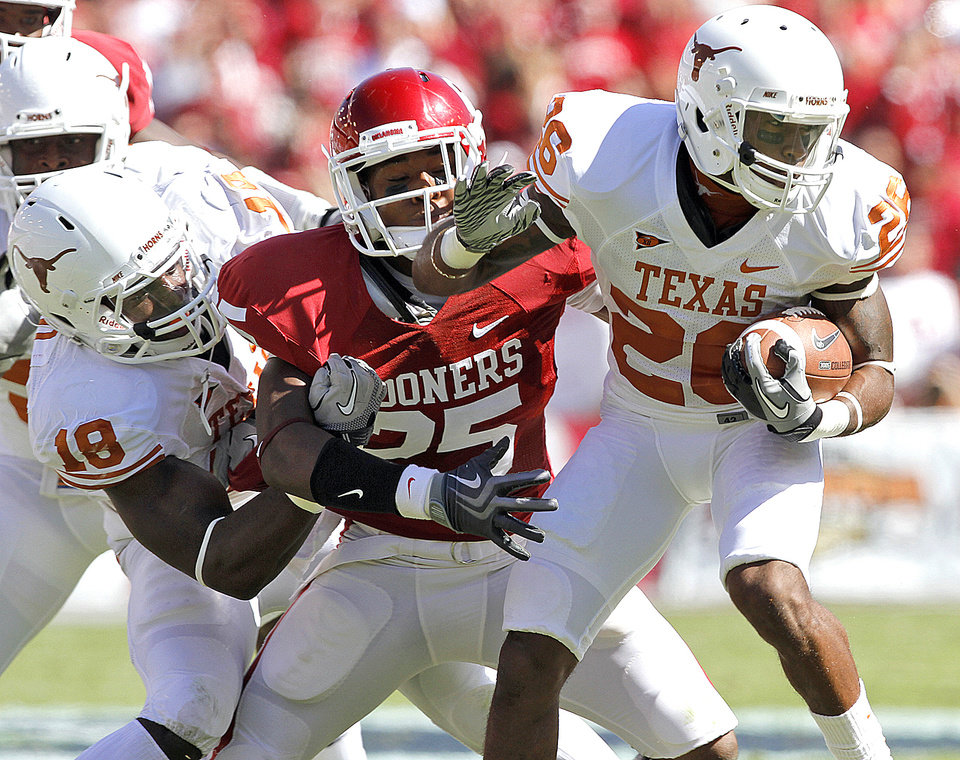 Texas� Emmanuel Acho, left, tries to keep Oklahoma�s Corey Nelson, center, from stopping Longhorn D.J. Monroe in the first half of the 2010 Red River Rivalry game. Nelson backs up weak-side linebacker Travis Lewis, but coach Bob Stoops will likely find other ways to get him on the field in the fall. Photo by Chris Landsberger, The Oklahoman