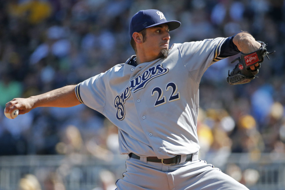 Photo - Milwaukee Brewers starting pitcher Matt Garza delivers during the first inning of a baseball game against the Pittsburgh Pirates in Pittsburgh Saturday, June 7, 2014. (AP Photo/Gene J. Puskar)