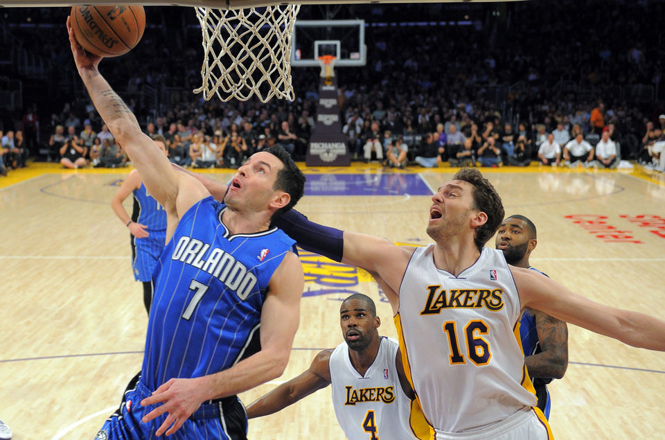 Orlando Magic guard J.J. Redick, left, puts up a shot as Los Angeles Lakers forward Pau Gasol, of Spain, defends during the first half of their NBA basketball game, Sunday, Dec. 2, 2012, in Los Angeles. (AP Photo/Mark J. Terrill)