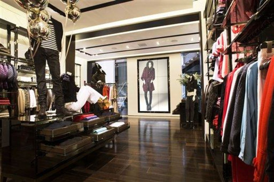 Photo - This undated publicity photo provided by BURBERRY shows an interior of the BURBERRY BRIT section of the new BURBERRY Flagship store opened in November 2012 on Michigan Avenue in Chicago. BURBERRY has been known for generations for its signature check pattern and trenchcoat.  The company has monthly updates at Burberry.com, where CEO, Angela Ahrendts said, more people visit every week than walk into all the brand's stores around the world combined.   (AP Photo/BURBERRY)