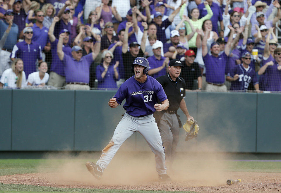 Photo - TCU's Jerrick Suiter celebrates scoring on teammate Kyle Bacak's bunt for an RBI, on what would be the game winning run, during the ninth inning of an NCAA college baseball tournament super regional game against Pepperdine in Fort Worth, Texas, Monday, June 9, 2014. TCU won 6-5. (AP Photo/Brandon Wade)