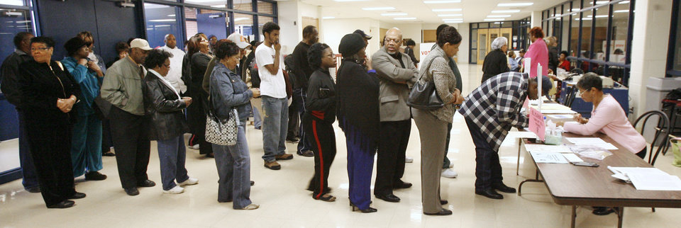 Photo - Voters line up to sign the voting log at precinct 551, Millwood High School, in Oklahoma City Tuesday, Nov. 4, 2008.  BY PAUL B. SOUTHERLAND, THE OKLAHOMAN