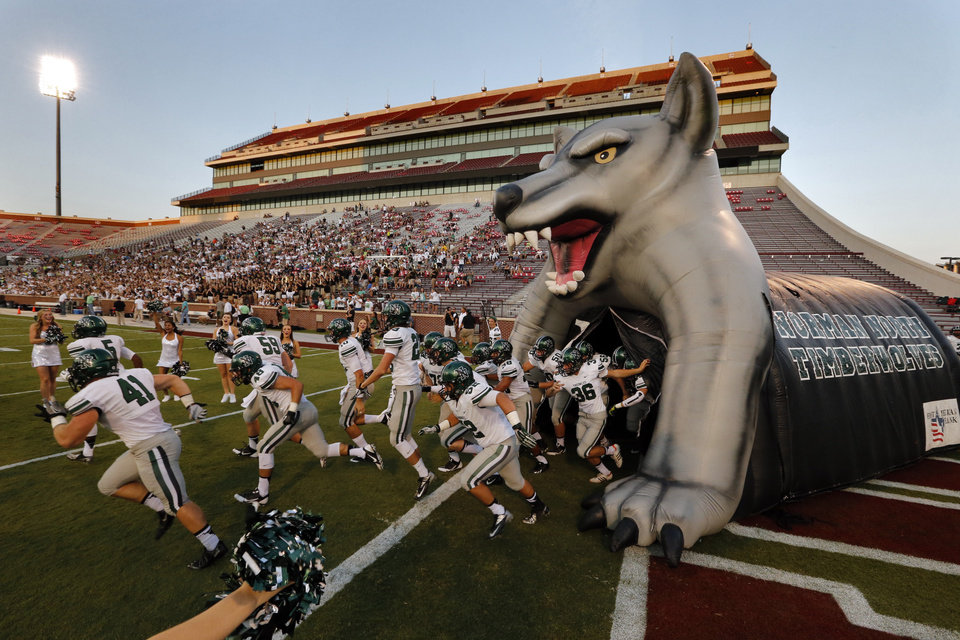 Photo - Norman North Timberwolves enter the field to play the Norman High School Tigers at Gaylord Family-Oklahoma Memorial Stadium in Norman, Okla., on Thursday, Sept. 5, 2013. Photo by Steve Sisney, The Oklahoman