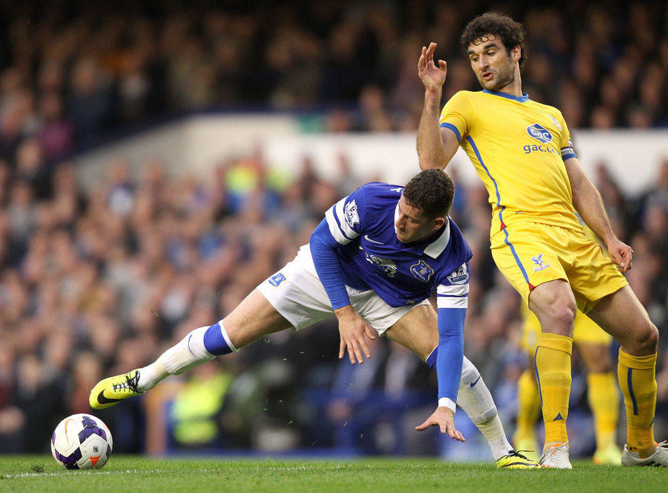 Photo - Everton's Ross Barkley, left, and Crystal Palace's Mile Jedinak battle for the ball during their English  Premier League match at Goodison Park, Liverpool, Wednesday April 16, 2014. (AP Photo/Barry Coombs/PA) UNITED KINGDOM OUT