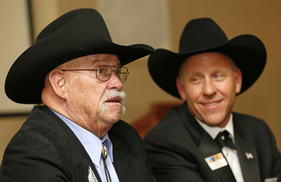 Photo - Lincoln Lageson, right, watches Barry Corbin speaks during the press conference before the Western Heritage Awards at the National Cowboy & Western Heritage Museum in Oklahoma City, Saturday, April 20, 2013. Corbin and Lageson are at the ceremony to receive the Television Feature Film award for
