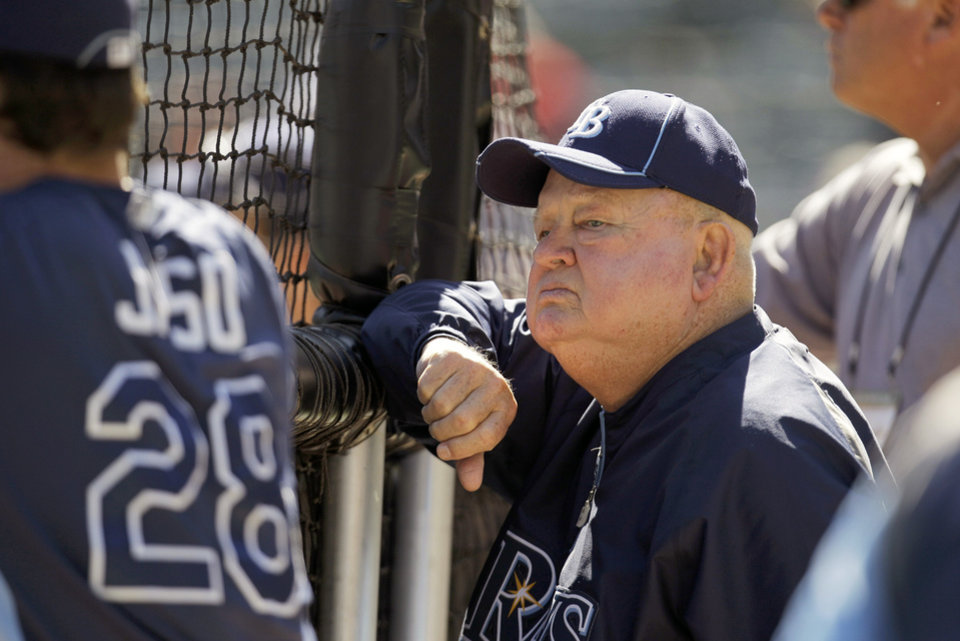 Photo - FILE - In this Sept. 30, 2011 file photo, former manager Don Zimmer watches the Tampa Bay Rays batting practice before Game 1 of baseball's American League division series playoffs against the Texas Rangers in Arlington, Texas. Don Zimmer, a popular fixture in professional baseball for 66 years as a manager, player, coach and executive, has died. He was 83. (AP Photo/Tony Gutierrez, File)