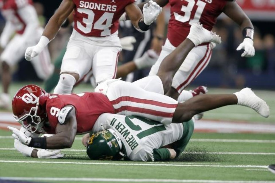 Photo -  Oklahoma linebacker Kenneth Murray (9) brings down Baylor quarterback Charlie Brewer (12) in the first half of Saturday's Big 12 Championship at AT&T Stadium in Arlington, Texas. Brewer did not play in the second half. [Bryan Terry/The Oklahoman]