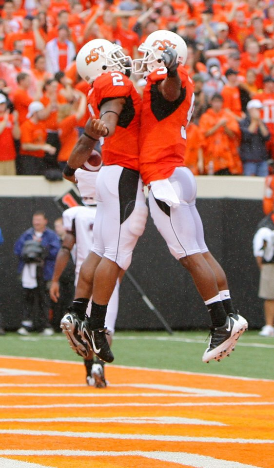 Photo - Beau Johnson (2) and Keith Toston do a chest bump after Johnson's TD at the Oklahoma State University (OSU) football game against Missouri State University (MSU) Saturday Sept. 13, 2008 at Boone Pickens Stadium in Stillwater, Okla. BY MATT STRASEN, THE OKLAHOMAN.