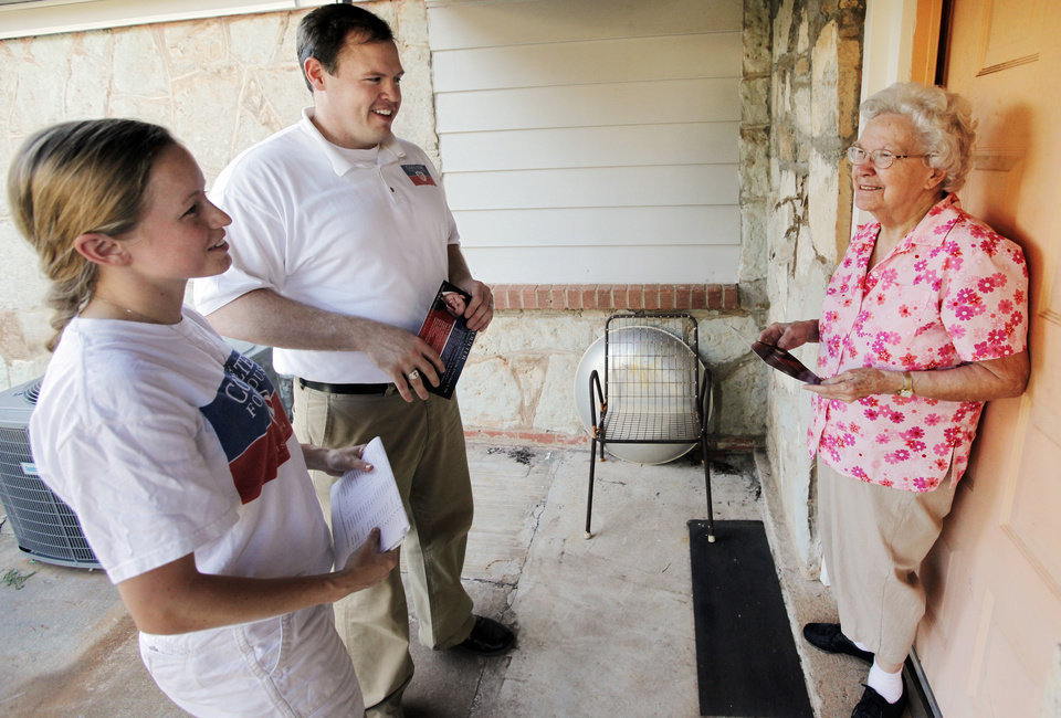 Kyle Coulter, candidate for the Oklahoma House of Representatives, middle, and his wife, Amy Coulter, left, talk with potential voter Betty Meador as the Coulters campaign door to door in the neighborhood southwest of SE 15 and Sunnylane in Del City, Oklahoma, Friday, June 18, 2010. Photo by Nate Billings, The Oklahoman