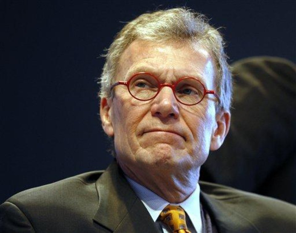 Photo - In this Dec. 5, 2008 file photo, former U.S. Senate Majority leader Tom Daschle, who is the nominee for health and human services secretary in the Obama administration, watches a film before his speech about plans for reforming the country's health care system during the 2008 Colorado Health Care Summit in Denver. Daschle apologized Monday Feb. 2, 2009 for delinquent tax payments saying he was