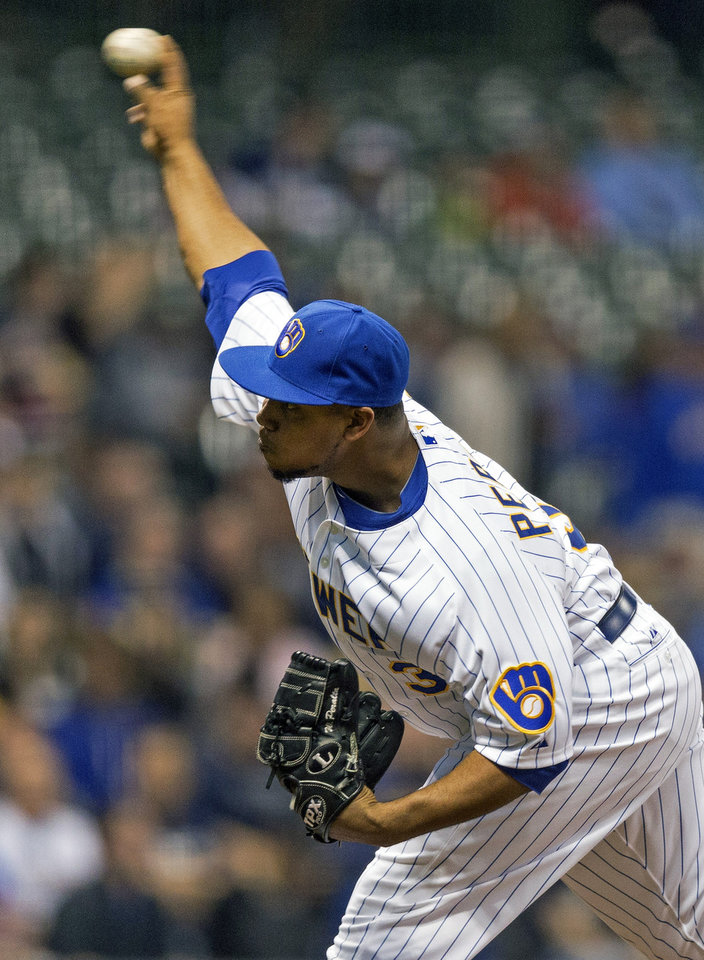 Photo - Milwaukee Brewers' Wily Peralta pitches to Pittsburgh Pirates' Starling Marte during the first inning of a baseball game on Friday, April 11, 2014, in Milwaukee. (AP Photo/Tom Lynn)