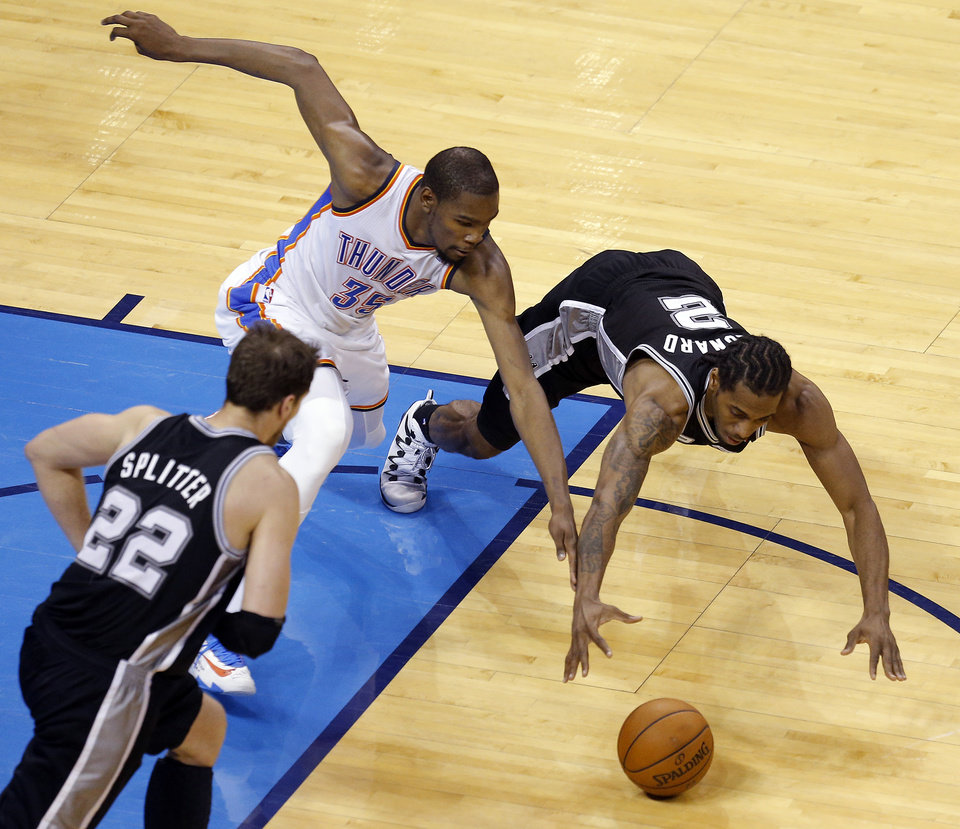 Photo - Oklahoma City's Kevin Durant (35) scrambles for a ball with San Antonio's Kawhi Leonard (2) and Tiago Splitter (22) during Game 4 of the Western Conference Finals in the NBA playoffs between the Oklahoma City Thunder and the San Antonio Spurs at Chesapeake Energy Arena in Oklahoma City, Tuesday, May 27, 2014. Photo by Bryan Terry, The Oklahoman