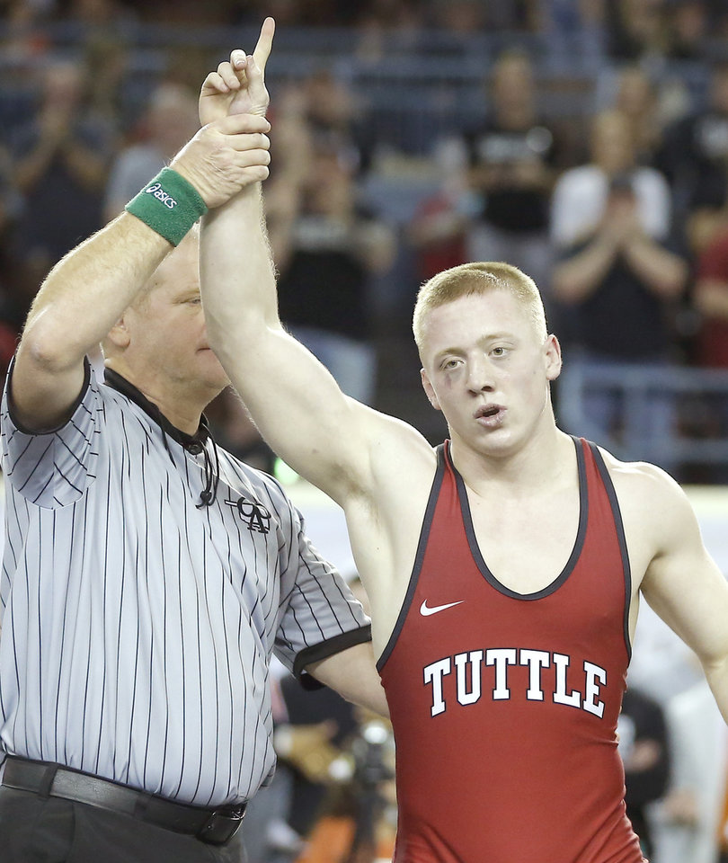 Photo - Tuttle 160-pounder Gage Shetley raises his hand Saturday after winning the Class 4A state tournament title at State Fair Arena. [Bryan Terry/The Oklahoman]