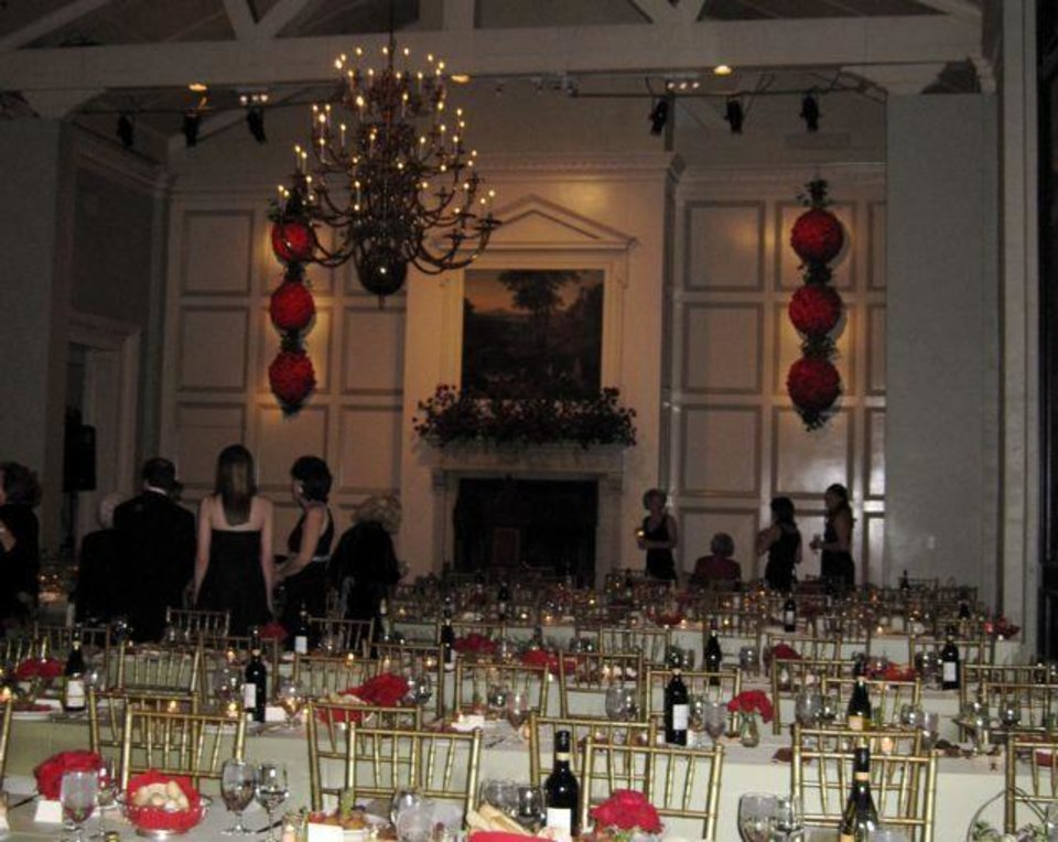 BEAUX ARTS BALL...Roses were on the mantle of the Oklahoma City Golf  and Country Club. (Photo by Helen Ford Wallace).