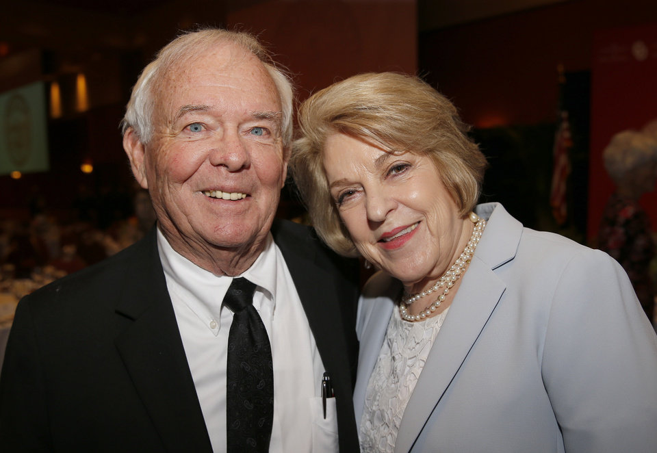 Photo - Dave and Judi Proctor pose for a picture before a dinner and reception honoring David and Molly Shi Boren in Norman, Okla., Friday, April 20, 2018. Photo by Sarah Phipps, The Oklahoman