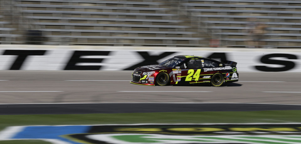 Photo - Driver Jeff Gordon (24) speeds down the strait away practice for Sunday's NASCAR Sprint Cup series auto race at the Texas Motor Speedway in Fort Worth, Texas, Friday, Nov. 1, 2013.  With only three races left in the NASCAR championship chase, and third in the standings, Gordon needs one of those good finishes at the track, where he has 11 top-10 finishes, but also two last-place finishes. (AP Photo/LM Otero)