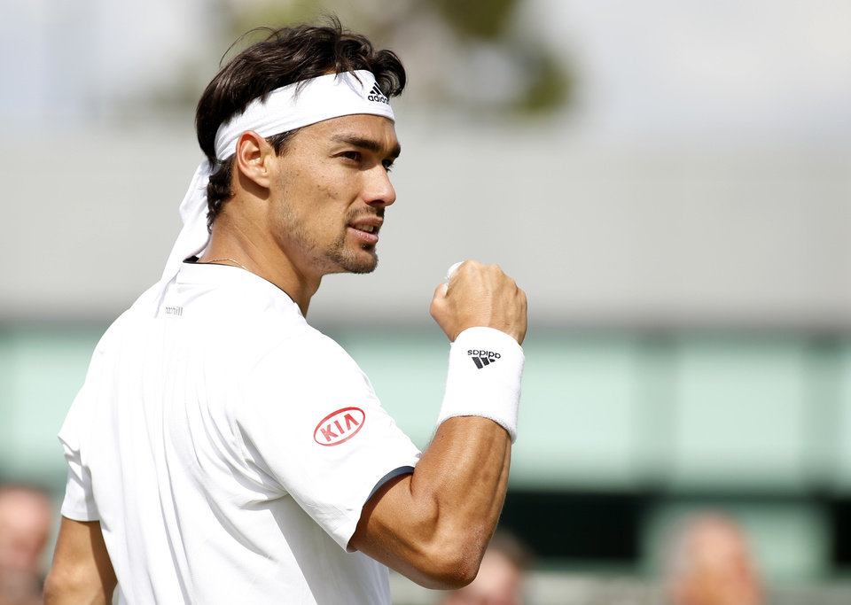 Photo - Fabio Fognini of Italy celebrates winning a game against Tim Puetz of Germany during their match at the All England Lawn Tennis Championships in Wimbledon, London, Wednesday, June 25, 2014. (AP Photo/Alastair Grant)