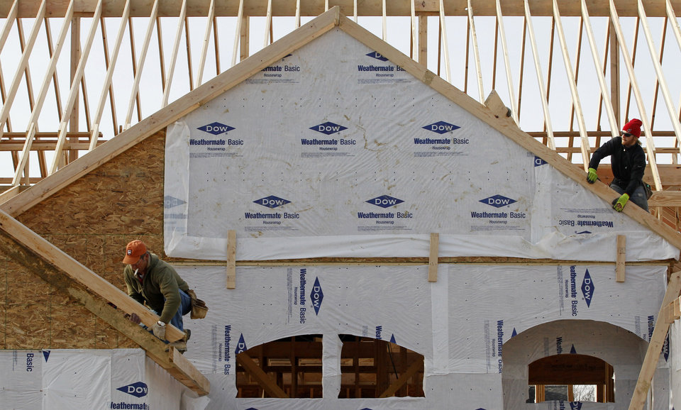 """In this Thursday, Dec. 6, 2012 photo a new home is constructed in Pepper Pike, Ohio. A measure of the U.S. economy designed to signal future activity increased in December from November, suggesting growth may strengthen in 2013. """"Housing, which has long been a drag, has turned into a positive for growth, and will help improve consumer balance sheets and strengthen consumption,"""" Conference Board economist Kenneth Goldstein said. (AP Photo/Tony Dejak)"""