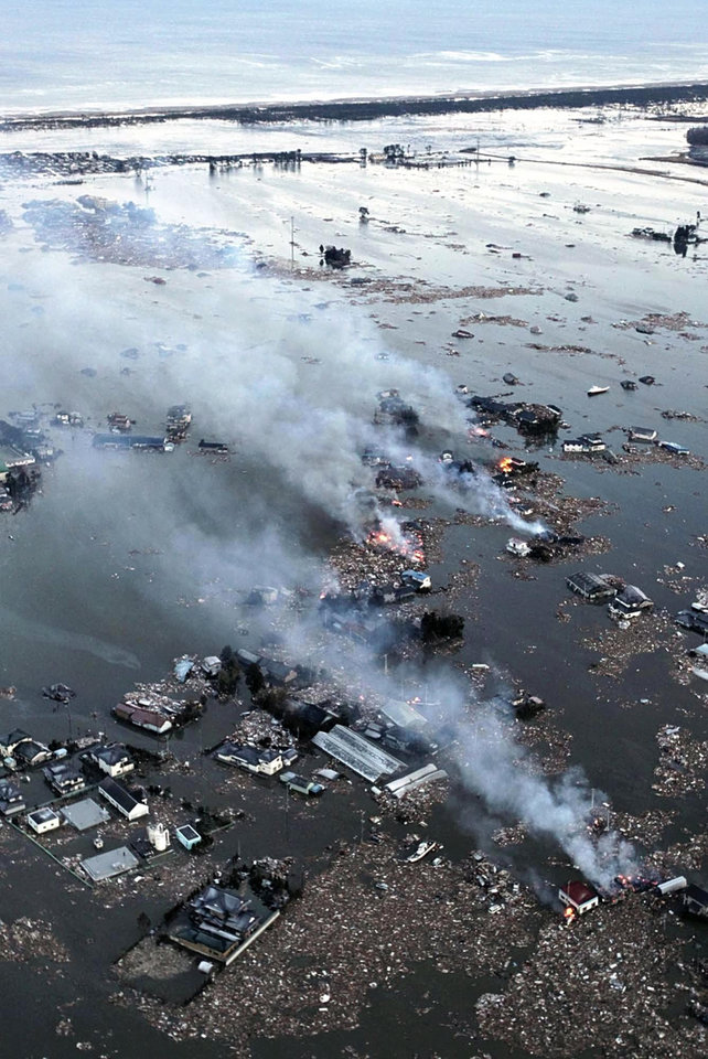 Photo - An aerial view shows houses burning and the Natori River flooded over the surrounding area in Natori, northern Japan, Friday, March 11, 2011. The largest earthquake in Japan's recorded history slammed the eastern coasts Friday. (AP Photo/Yasushi Kanno, The Yomiuri Shimbun) JAPAN OUT, CREDIT MANDATORY ORG XMIT: TOK853