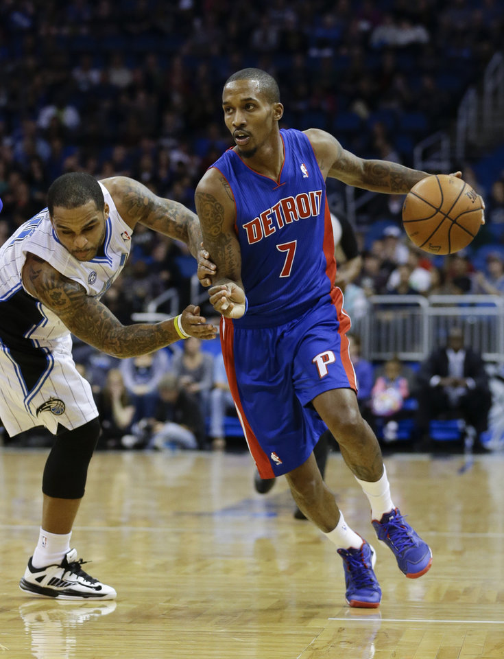 Photo - Detroit Pistons' Brandon Jennings (7) drives to the basket past Orlando Magic's Jameer Nelson, left, during the first half of an NBA basketball game in Orlando, Fla., Friday, Dec. 27, 2013. (AP Photo/John Raoux)