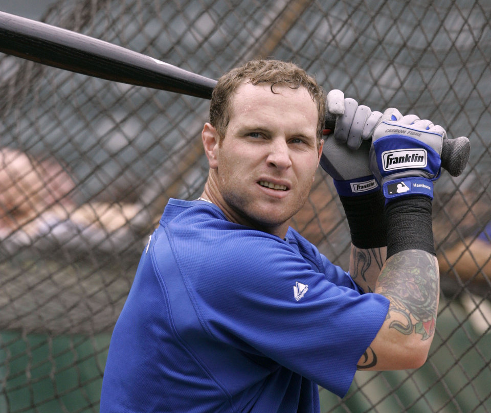 Photo - MAJOR LEAGUE BASEBALL: Texas Rangers outfielder Josh Hamilton pauses outside the cage during batting practice before the Rangers' baseball game against the Los Angeles Angels in Arlington, Texas, Tuesday, June 30, 2009. Hamilton is on the disabled list. (AP Photo/Donna McWilliam)  ORG XMIT: ARL101