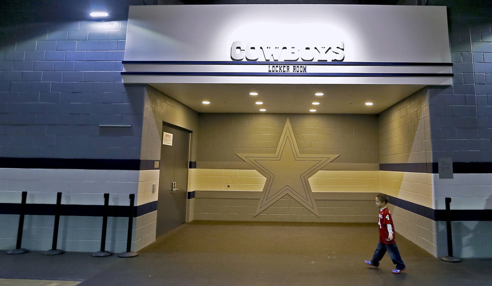 Garrett Herring, of Lawton, walks past the Dallas Cowboys locker room during the college football Cotton Bowl game between the University of Oklahoma Sooners (OU) and Texas A&M University Aggies (TXAM) at Cowboy\'s Stadium on Friday Jan. 4, 2013, in Arlington, Tx. Photo by Chris Landsberger, The Oklahoman