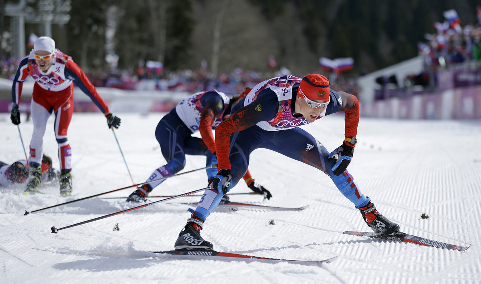 Photo - Russia's Alexander Legkov crosses the finish to win the gold medal in the men's 50K cross-country race at the 2014 Winter Olympics, Sunday, Feb. 23, 2014, in Krasnaya Polyana, Russia. (AP Photo/Gregorio Borgia)
